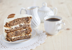 Single piece of Hummingbird cake with pecans with coffee